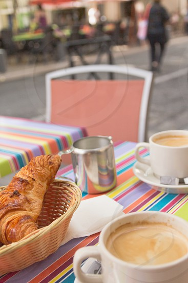 French  breakfast with croissants coffee and milk on the Provencal street (Arles Provence France) photo