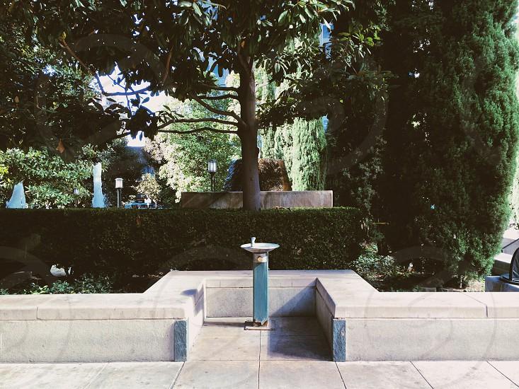 blue ceramic drinking fountain photo