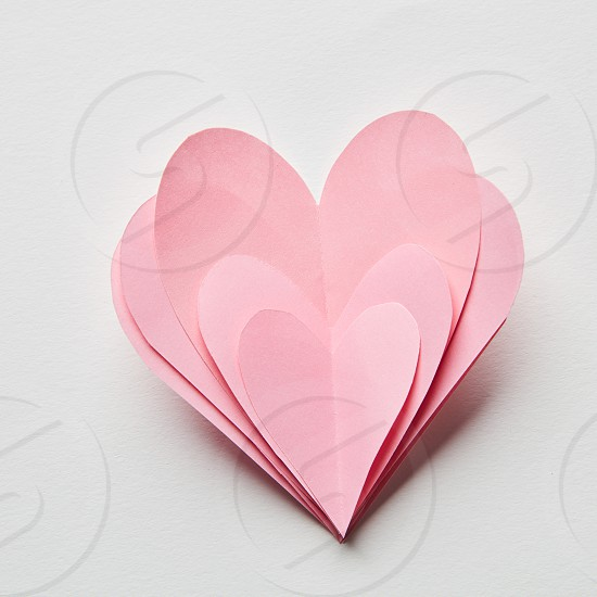 Beautiful hand made pink hearts on a white background photo