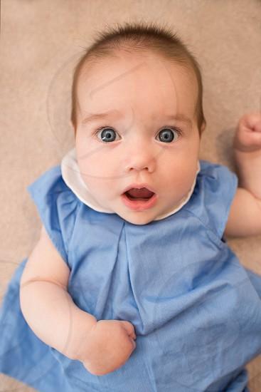 baby surprised portrait blue expressive photo