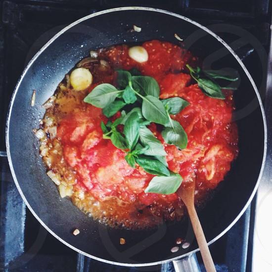 tomato garlic basil sauce in skillet photo