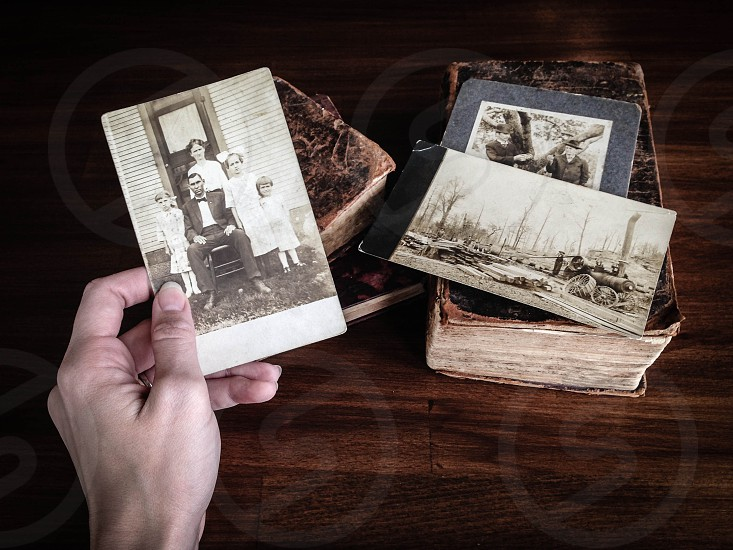 Antique photos and books. Digging into your family history.  photo