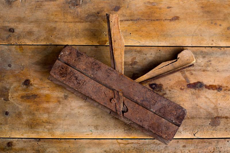 carpenter vintage wood planer tool planer rusted on retro  background photo
