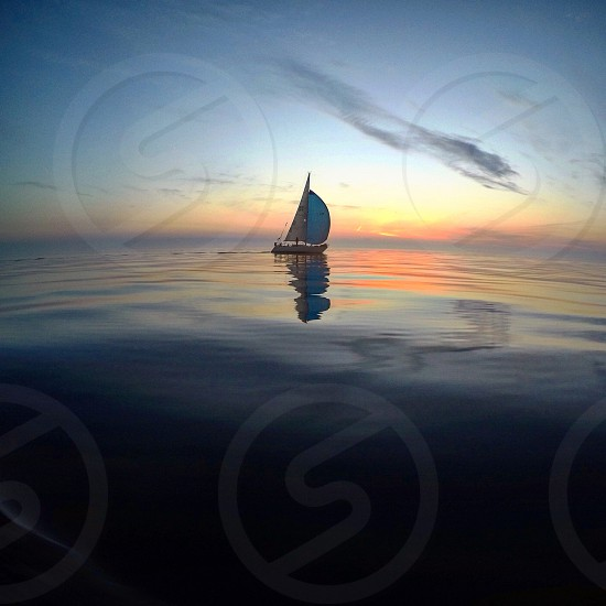 Sailing sail boat sailboat sunset outside nature beautiful adventure explore lake photo