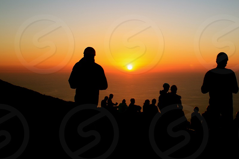 Watching sunset atop the Stromboli Volcano in Sicily Italy photo