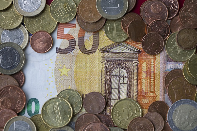 Bigger denomination of 50 Euros surrounded by smaller denominations euro cents photo