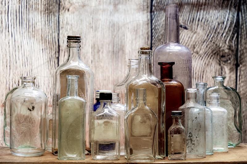 Old Glass Bottles on a shelf. photo