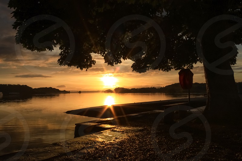 Reflection lake water sunset nature landscape Ireland Killarney pier tree photo