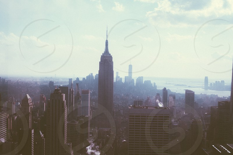 empire state building in the middle of the city photo