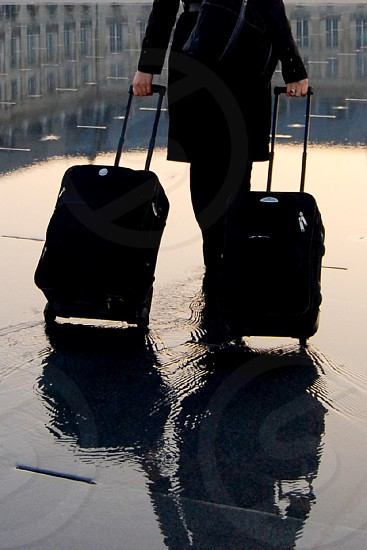Traveller with suit cases - Early morning in center of Bordeaux photo