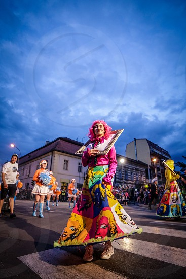 Pancevo - Serbia 06.17.2017. Girl costumed in dress with pictures of Merlin Monroe on carnival parade photo