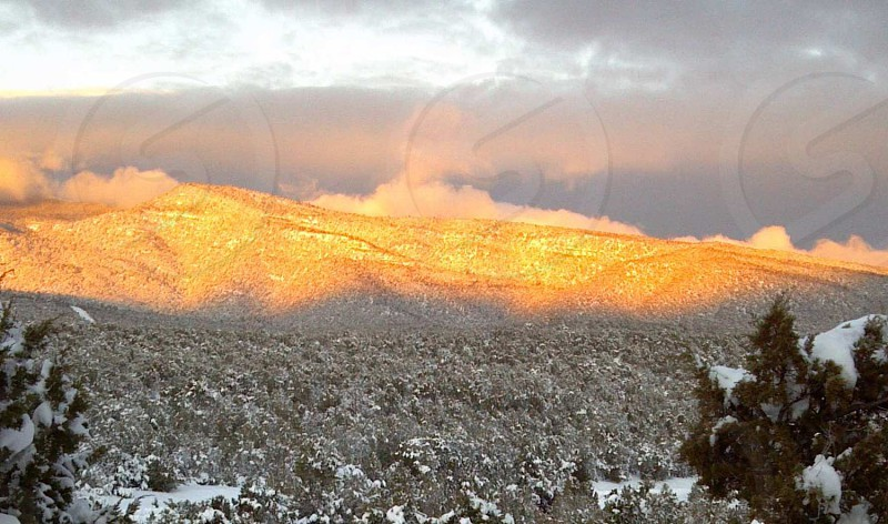 Sunrise on the Sandia Mountains New Mexico photo