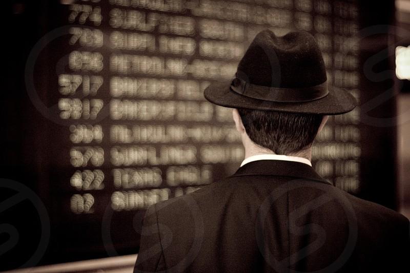 man wearing black hat and black suit photo