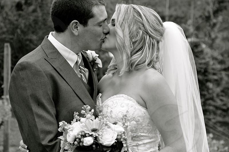 grayscale of wedding photograp photo