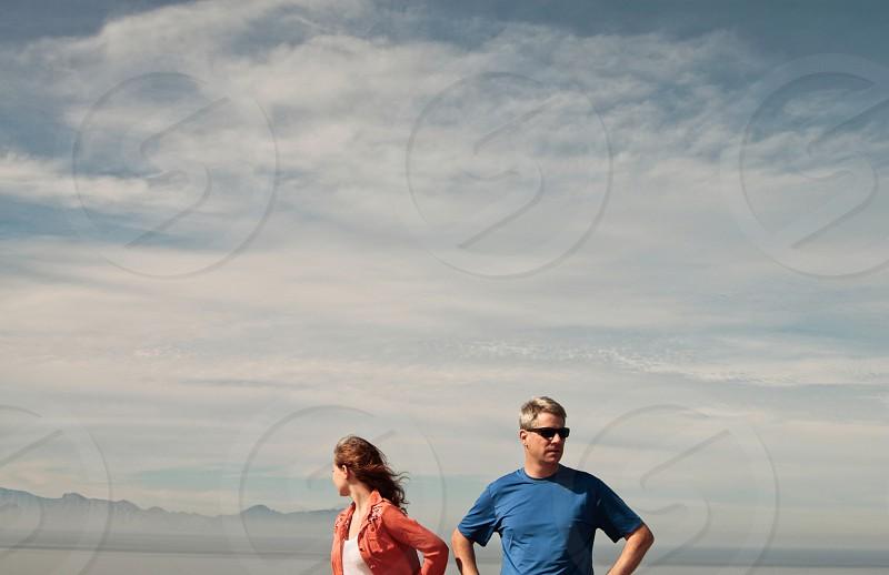 man inblue t shirt standing beside woman photo