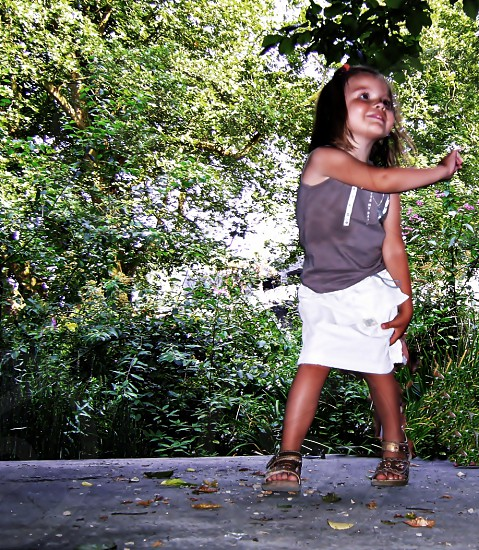 little girl dancing on a table photo