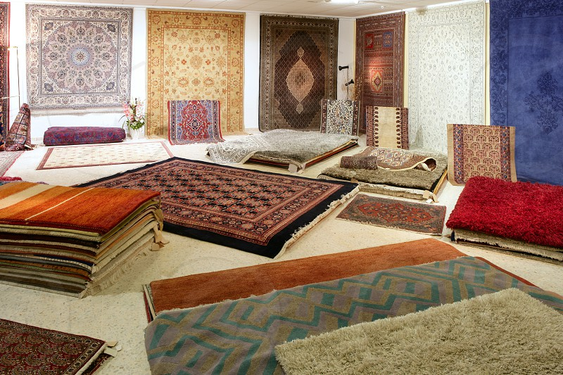 Arabic carpet shop exhibition colorful carpets exposition room photo