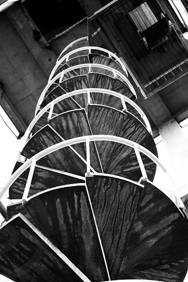 Spiral Outdoor Stairway looking from ground upwards. photo