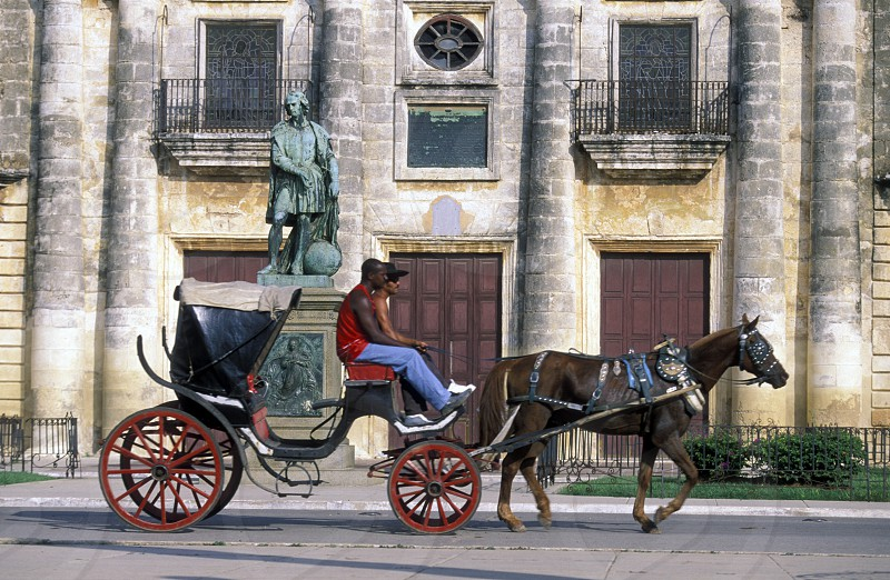 a horse cart Taxi transport in the old town of cardenas in the provine of Matanzas on Cuba in the caribbean sea. photo