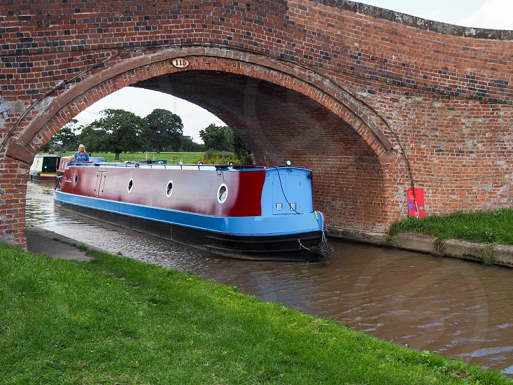 Narrow Boat Travelling along the Shropshire Union Canal photo