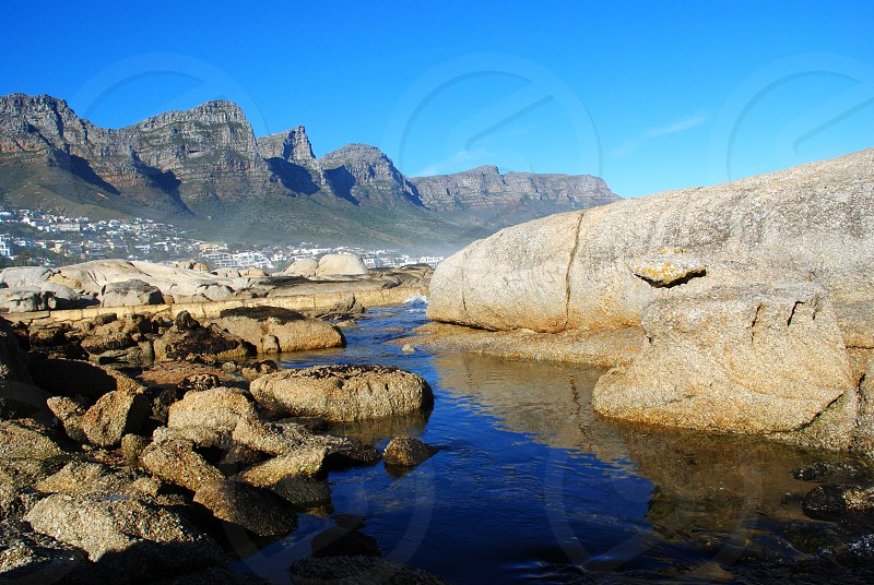 beige rocks formation beside river over sunrise view photo
