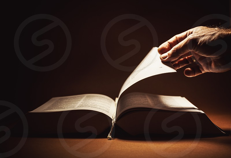 Conceptual composition about reading a book. Looks like dictionary or an encyclopedia. photo