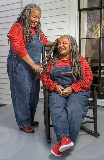 twin african-american sisters with dreadlocks photo
