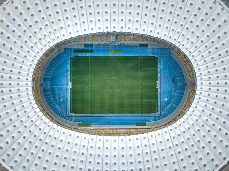 KIEV UKRAINE - July 19 2018. Top view strrictly above the football Stadium National Sports Complex Olimpiysky with roof of the stadium green football field stands. Aerial view from drone. photo