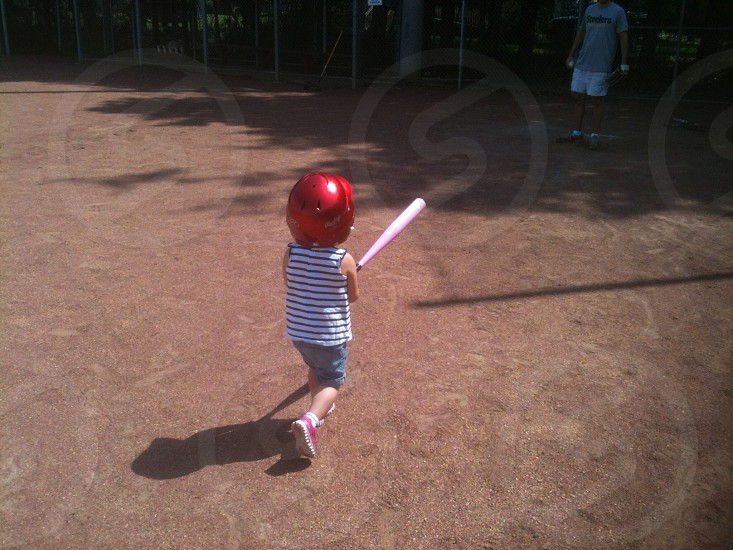 Young girl with baseball bat. photo