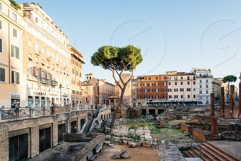 Largo di Torre Argentina at sunset It is a square with four roman Republican temples and the remains of Pompey's Theatre. It is in the ancient Campus Martius photo
