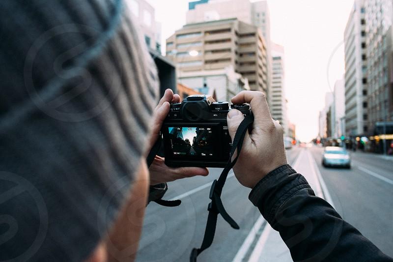 Male photographer taking a photo photo