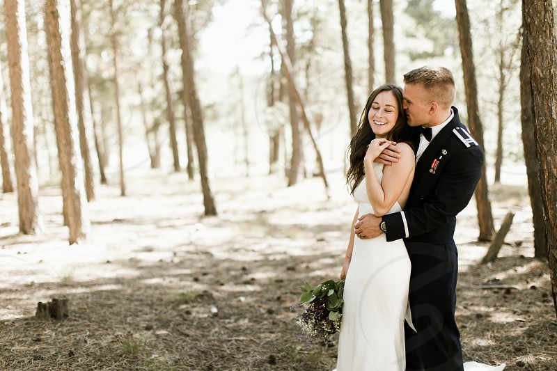 bride and groom in the forest photo