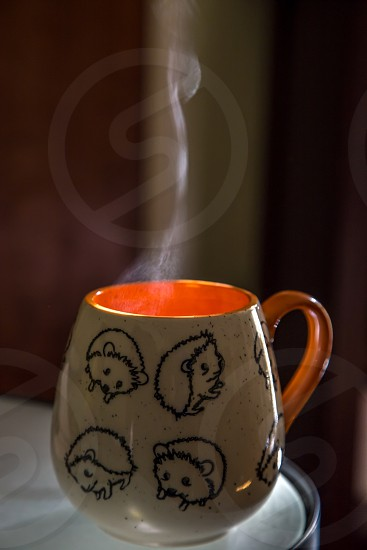 Steam coming off hot coffee mug photo