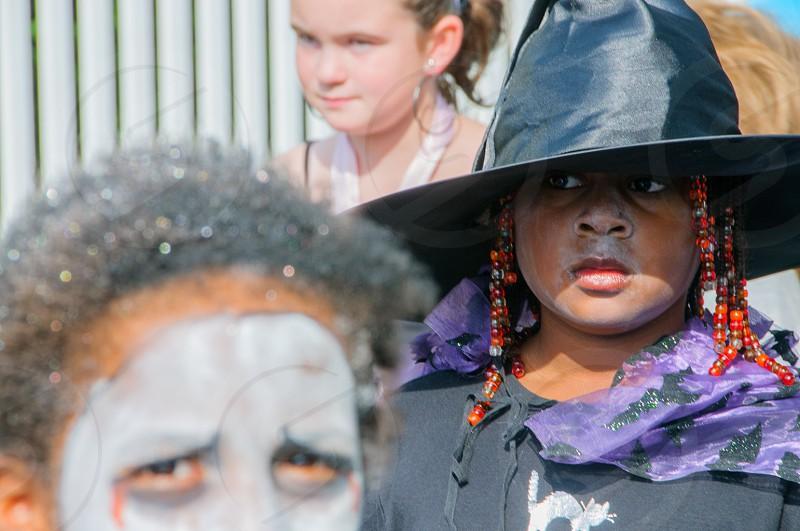 woman wearing black hat and purple black scarf photo