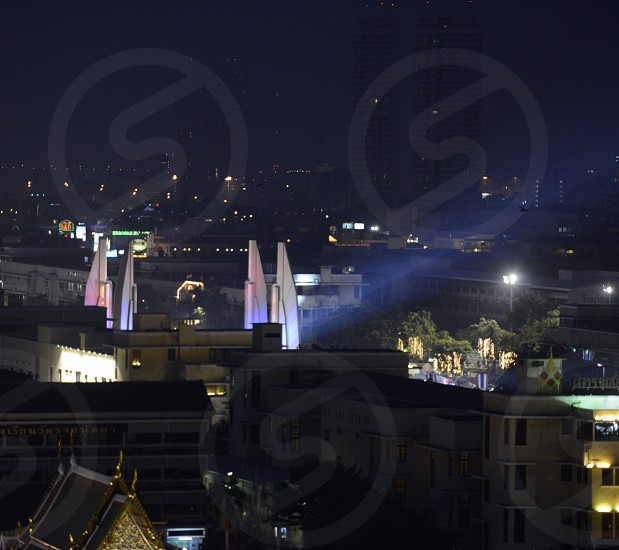 the Democracy Monument by night in the city of Bangkok in Thailand in Southeastasia. photo