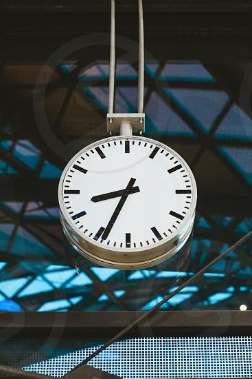 Clock in railway station photo