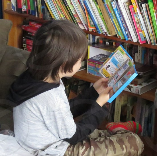 A child enjoying library reading during schooling time. photo