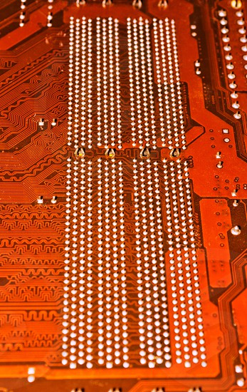 Motherboard circuits for damaged PC  have been reviewed by a qualified technician. Back of circuit board. photo