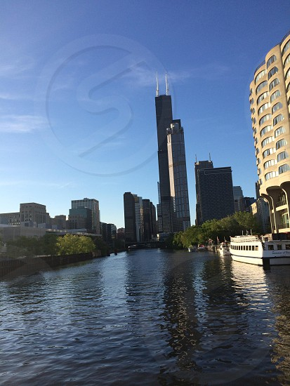 A view of the Sears (Willis) Tower from a boat going through the Chicago River.  photo