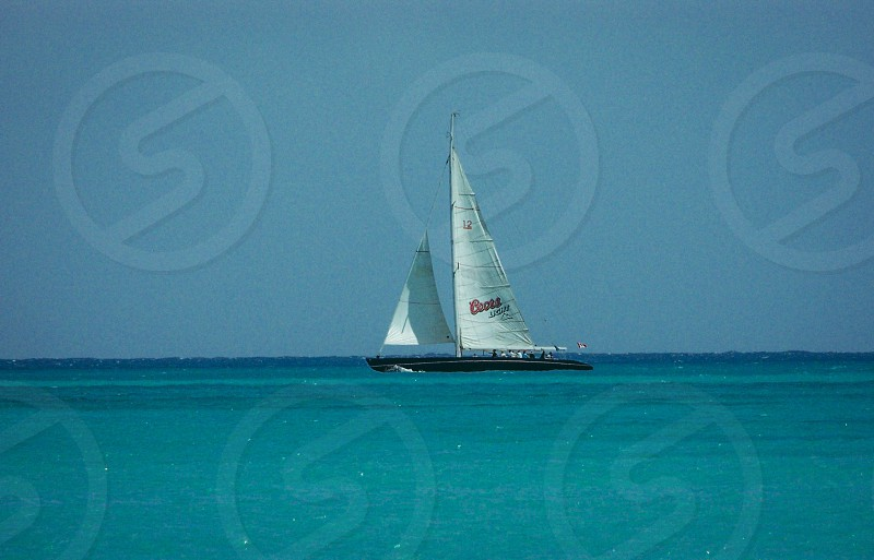 Sail boat beach ocean photo