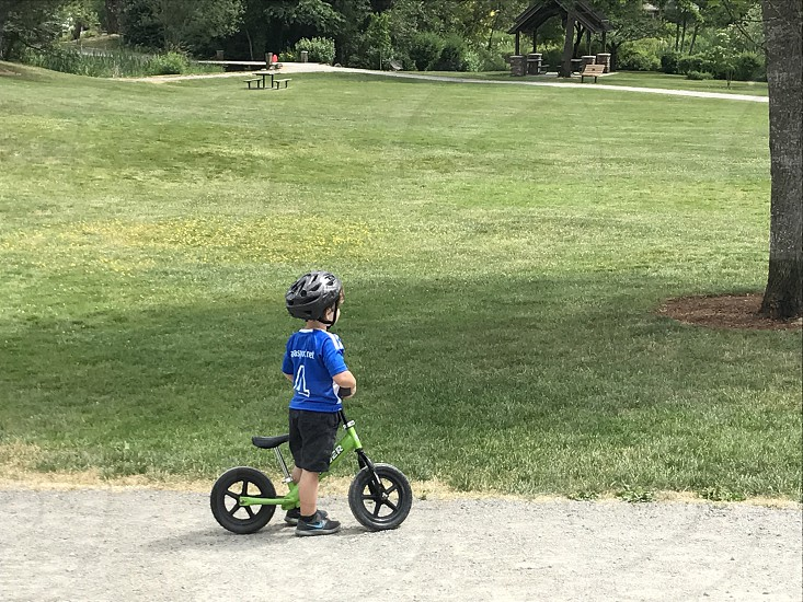 Scooting along at the park. photo