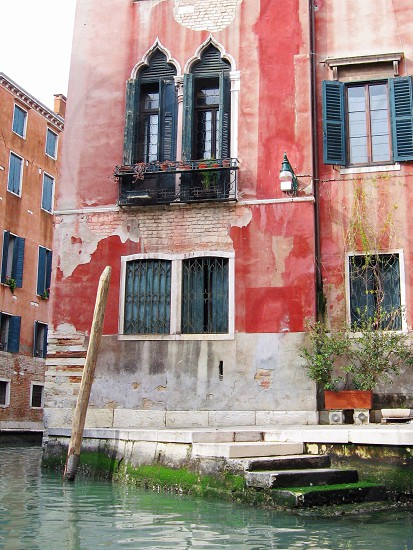 The beautiful texture and colour of Venetian architecture in Venice Italy. photo
