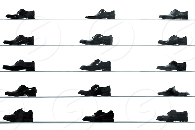 shop shopping shoes footwear display clothing shelves silhouette store mens black and white row black friday luxury boutique sale buy group many photo