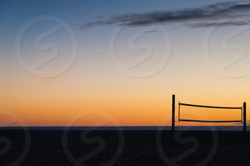 Half dark sand half late sunset sky photo