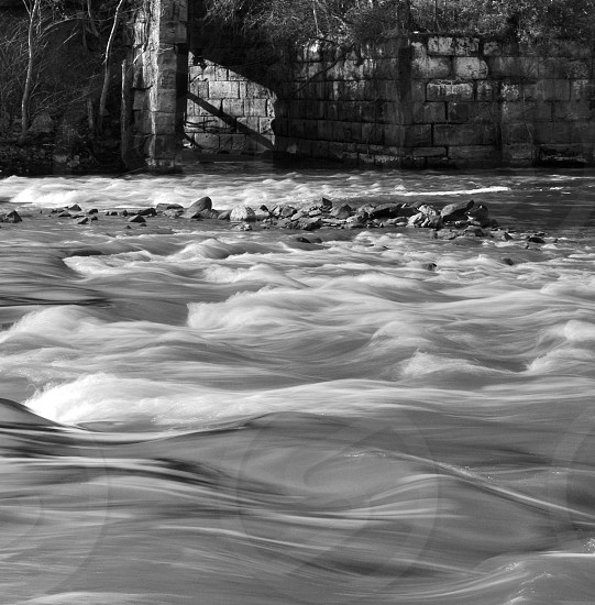 Waves. Water. Old stone. Brick. Motion. Monochrome. Black and White. photo
