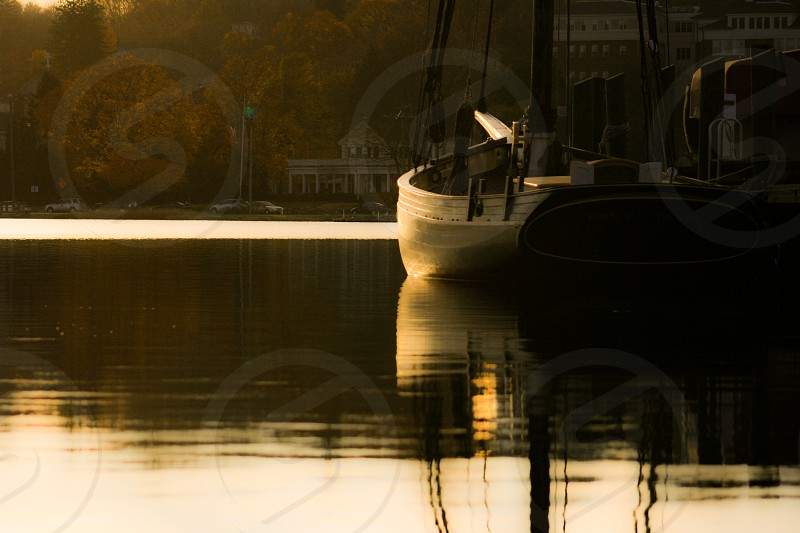 sepia tone boats on water photography   photo