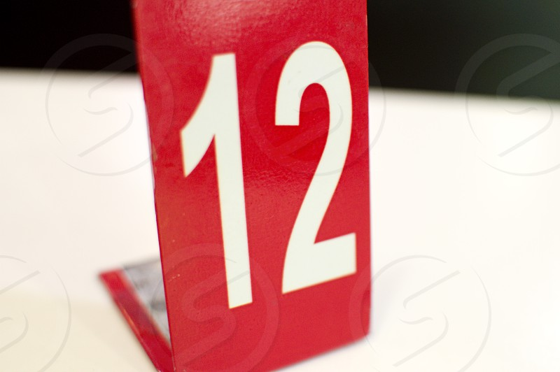 A number twelve text in white and red color photo