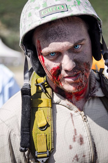 close-up photography of soldier zombie photo