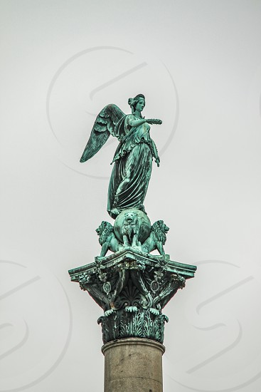 woman with wings statue photo
