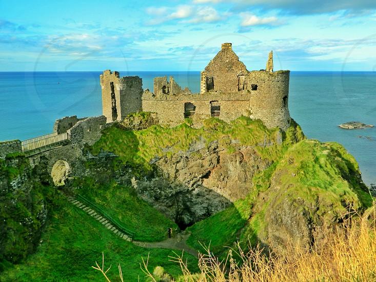 Dunluce castle overlooking Atlantic Ocean photo